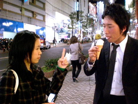 Al and her would-be Japanese boyfriend Kenji share an icecream cone from McDonalds, Shibuya.