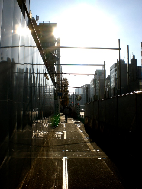 through a construction site. shimbashi, mid-morning.