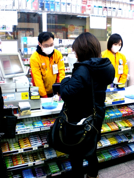 those employees do not have SARS. In Japan if you are sick you wear a face mask so you don't get others around you sick too.
