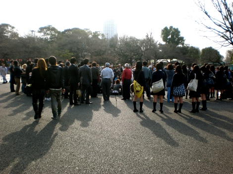 They're surrounding a street performer outside of the Tokyo National Museum & the Ueno Zoo