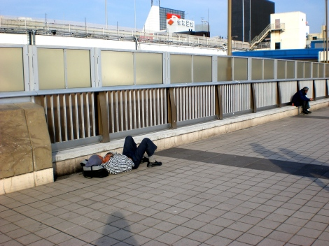 Homeless people in Japan, as far as I've seen, seem by and large to just be very old men. Of course I don't even know for sure if he's homeless...maybe he just wanted to nap in the sunshine?