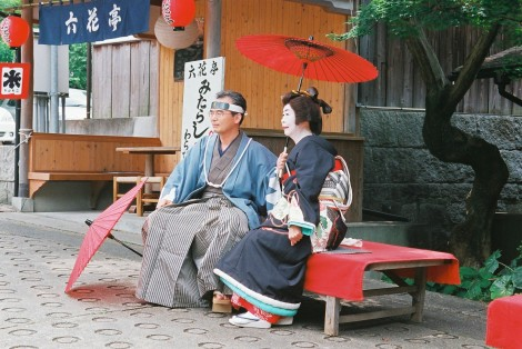 A grown-up Geisha & her man posing in a little photoshoot.